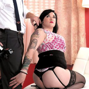 Busty brunette babe Scarlet LaVey posing in stockings and garters