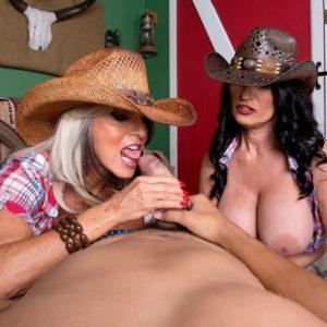 Older women Sally D'Angelo and Rita Daniels tongue kissing