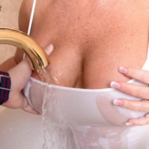 Busty over 40 MILF Zena Rey letting big natural tits loose in bathtub