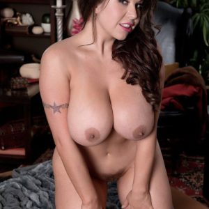 Busty brunette babe Sheridan Love playing with big natural tits