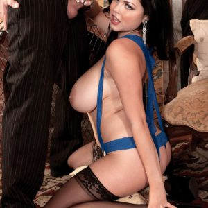 Busty brunette babe Shione Cooper giving a tit fucking in stockings