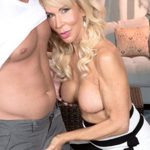 Busty blonde grandmother Erica Lauren having pussy licked by younger man