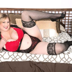 Fat blonde model Amiee Roberts posing in stockings and high heels