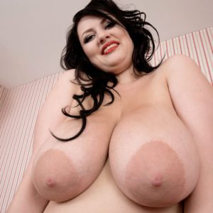 Chesty solo model Barbara Angel playing with huge natural tits