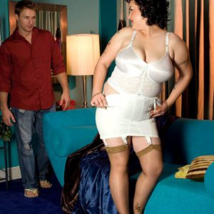 Big woman Gwen Etoile removes girdle before exposing large natural breasts