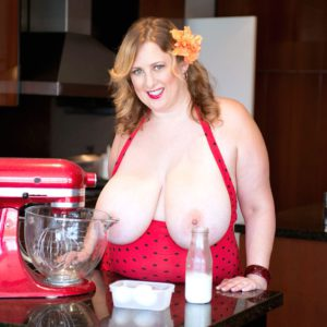 Chunky blonde Aimee Roberts letting massive knockers loose in kitchen