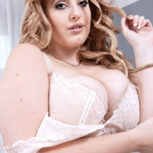 Blonde BBW Ellie Roe posing for solo shoot in sexy lingerie