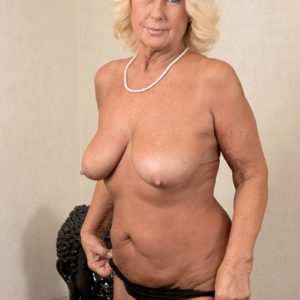 Nylon and skirt attired MILF over 60 freeing huge all natural granny tits and nipples