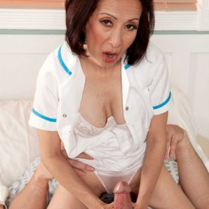Mature Asian lady Kim Anh jerking large dick in hospital room