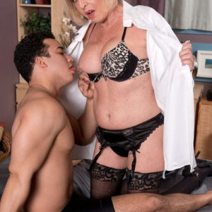 Over 60 model Scarlet Andrews seducing younger man for sex in lingerie and nylons