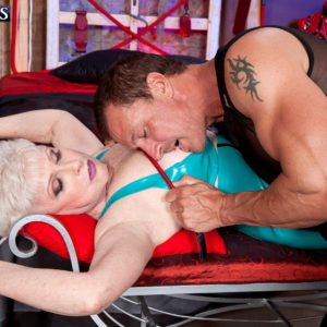 Stocking clad granny engaging in hardcore BDSM sex acts in latex dress and heels