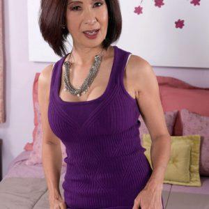 60 plus Asian granny Kim Anh flashing white upskirt panties