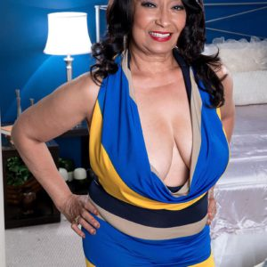 Busty 60+ MILF Rochelle Sweet unleashes fun bags for younger man