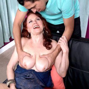 Mature redhead Katherine Merlot flashes upskirt undies to seduce stud