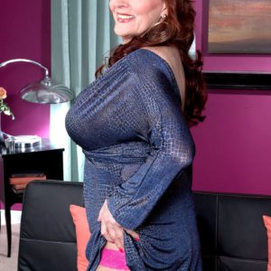 Mature redhead Katherine Merlot flashes upskirt undies to seduce stud