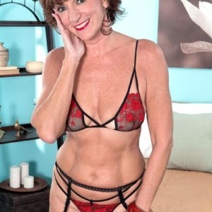 Petite over 60 model Sydni Lane posing in lingerie before sex with younger man