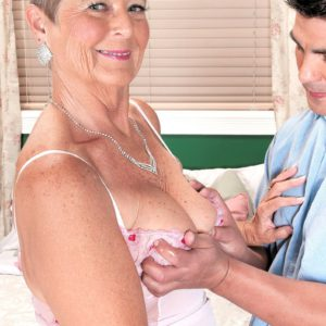Short haired over 60 GILF Joanne Price giving younger man's cock a blowjob