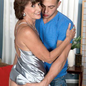 Over MILF Sydni Lane flashing upskirt panties to attract younger man
