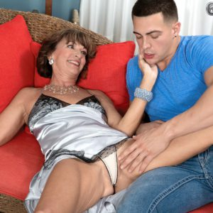 Over MILF Sydni Lane flashing upskirt panties to attract younger man