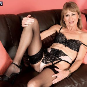 Stocking and lingerie attired grandma crossing and uncrossing legs in high heels