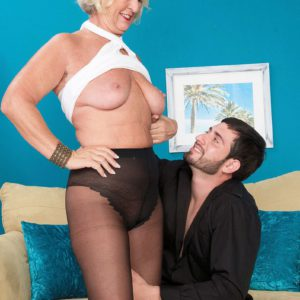 Topless granny Jeannie Lou giving younger man a blowjob