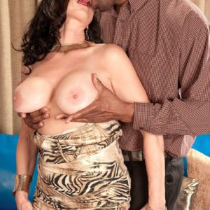 Older brunette pornstar Rita Daniels undressed for interracial sex by black stud
