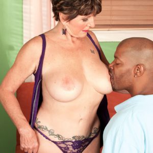Busty granny Bea Cummins fucks a black man in front of cuckold hubby