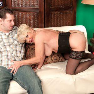 Mature blonde pornstar DeAnna Bentley giving younger man a blowjob