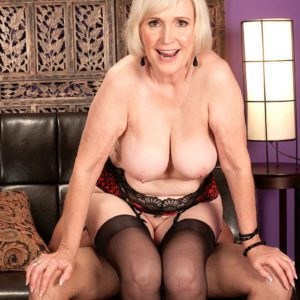 Over 60 granny Lola Lee giving a blowjob in stockings and garters