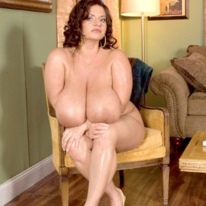 Buxom solo model Maria Moore flaunting her massive juggs