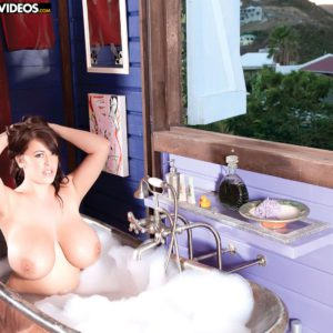 Buxom solo model Leanne Crow flaunting huge knockers in bubble bath