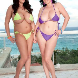 Busty babes Michelle Bond and Leanne Crow posing topless outdoors