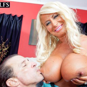 Over 50 MILF Annellise Croft uses big knockers to tit fuck long penis