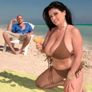 Dark haired babe Arianna Sinn loosing massive juggs on beach for nipple licking