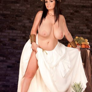 Chesty brunette chick Arianna Sinn letting huge knockers free from Toga outfit
