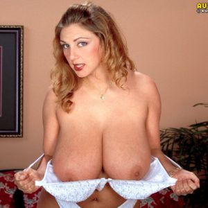 Chesty blonde solo model Autumn Jade lets large all natural tits loose from bra