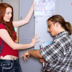 Redheaded schoolgirl Avalon receiving cunnilingus on teacher's desk