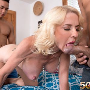 Over 50 blonde MILF Cammille Austin baring big tits during MMF threesome