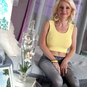 Over 50 blonde MILF Cammille Austin exposing large mature boobs in jeans