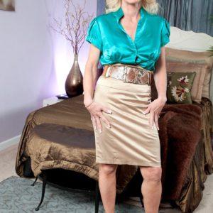 Over 50 blonde MILF Cammille Austin revealing erect nipples in peek a boo bra
