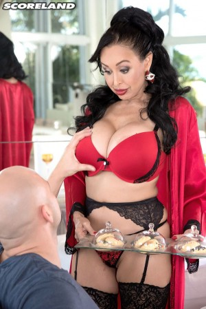 Buxom brunette Claudia KeAloha serving up food and pussy in stockings