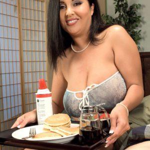 Busty brunette MILF Daylene Rio exposing nice melons before jerking large cock