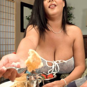 Busty brunette MILF Daylene Rio exposing nice melons before jerking large cock