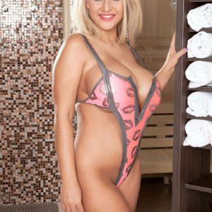 Blonde solo girl Dolly Fox exposing huge hooters in high heels