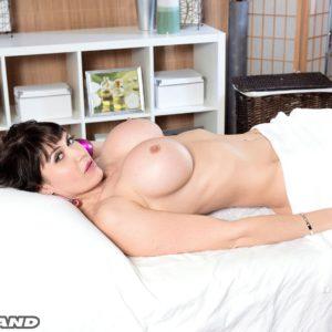 Chesty brunette Eva Karera setting her large tits free for massage
