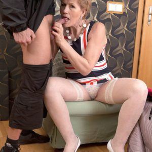 Over 50 cougar Georgina giving CFNM blowjob in stockings and heels