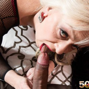 MILF over 50 Heidi licking and jerking off long cock in mesh bodystocking
