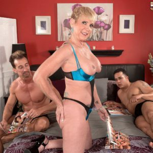 Lingerie attired 50 plus MILF Honey Ray baring big tit before giving MMF blowjob