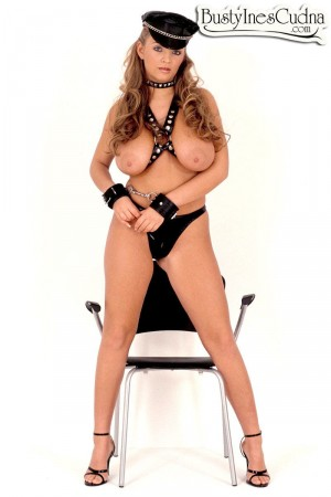 Topless blonde solo model Ines Cudna posing in handcuffs and hat