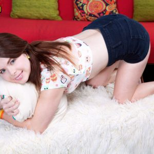 Barely legal cutie Jennifer Matthews undresses for nude pics on bed